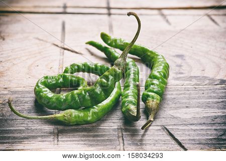 Hot Green Peppers On Wood Background