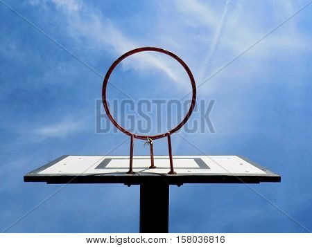 Basketball basket and blue sky in sport areal