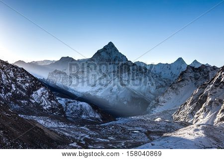 Ray Of Light Beaming Through Mountains In Front Of Ama Dablam Summit On The Famous Everest Base Camp