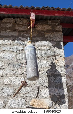 Old Oxygen Bottle And Hummer Work As A School Bell In The Remote Himalayan School Of Thame Village,