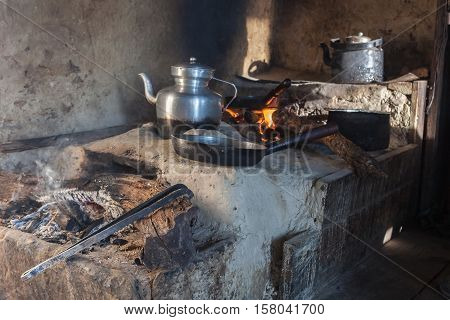 Traditional Kitchen In Old Nepali House In Small Remote Village In Himalayas With Open Fire Place, S