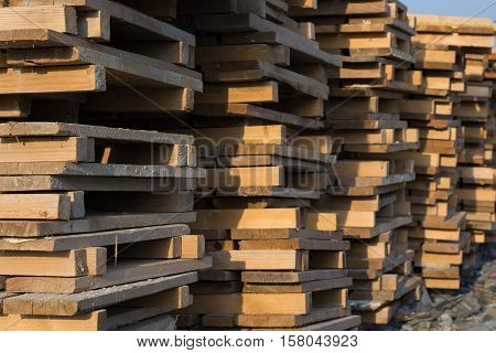 Large storehouse and many rows of wooden pallets