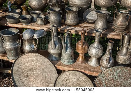 Antique jugs and dishes at antique shop at oriental marketplace