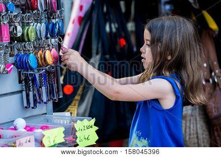 Paris, France- June 30, 2013:kid Choose A Tipical Souvenir Of Paris In A Shop Near Montmartre, The M