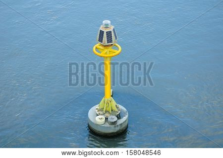 A solar powered warning buoy in the waters of Suzhou Creek in Shanghai China.