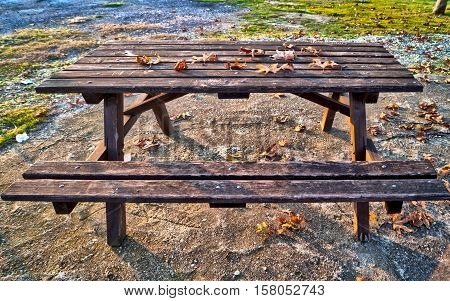 Solitary bench.Empty seat in a park in autumn. Found in the top of a mountain , HDR