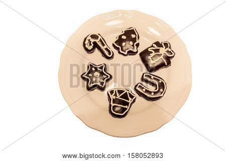 Chocolate glazed christmas cookies on plate isolated on white background