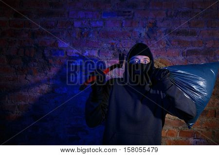 Astonished thief at near wall