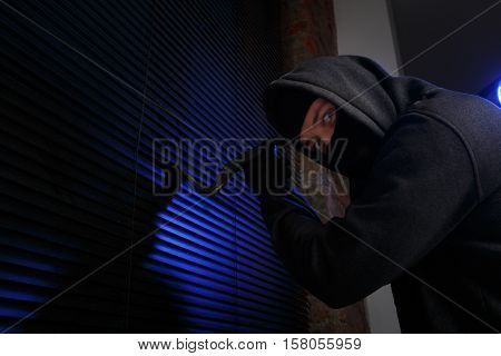 Robber with picklock at night