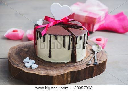 Homemade cake with heart shaped decoration on a wooden board
