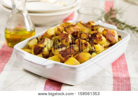 Roasted fried potatoes with garlic and rosemary