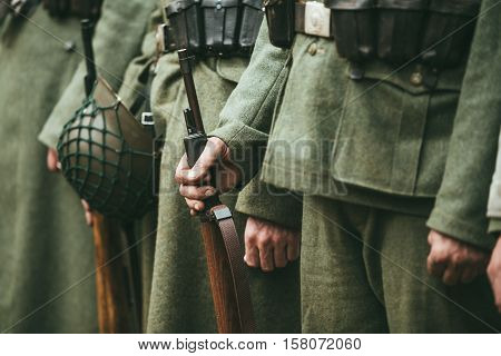Close up of german military ammunition of a German soldier. Unidentified re-enactors dressed as World War II German soldiers standing order.