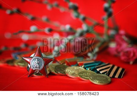 Awards of Merit in World War II by the Soviet Union on a vintage wooden background