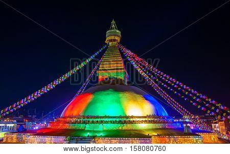 Renovated Boudhanath stupa lit for its inauguration in Kathmandu, Nepal