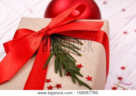 Silk Red Ribbon Holds Paper Present Box