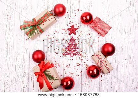 Red Present Boxes, Christmas Tree Toys Lie On White Wooden Table