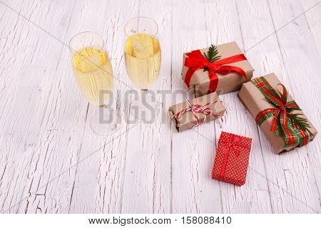 Champagne Flutes Stand Behind Boxes With Christmas Presents