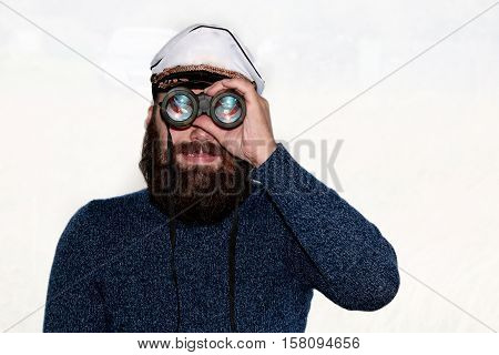 handsome and attractive man with a beard, posing at camera on an isolated white background