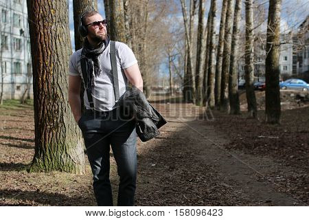handsome and attractive person in the summer in the landscape of city streets and parks