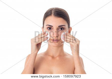 gorgeous girl takes care her skin with Cleansing cotton pad isolated on white background. Health care concept. Body care concept. Young woman with healthy skin.