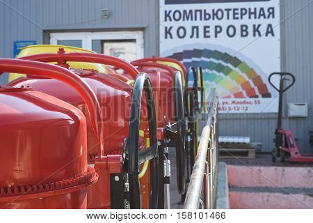 Domestic Concrete Mixer Stand In A Row On The Street At The Entrance To The Store. Sale Of Concrete
