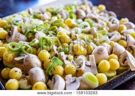 Vegetables: Potatoes, Mushrooms And Leek Ready For Roasting. Prepare The Roast.