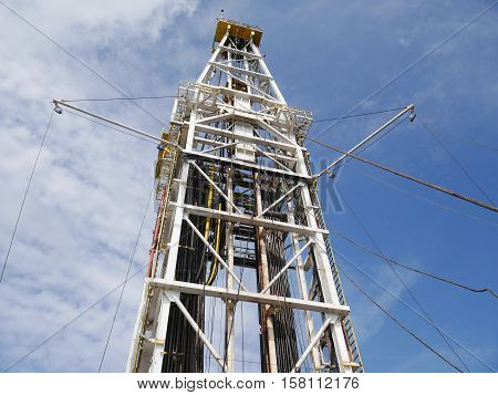 Drilling Rig Derrick on Sunny Day - Oil and Gas