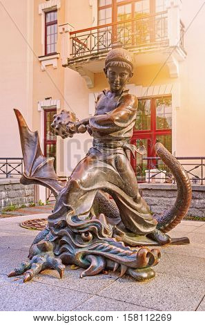 Kiev Ukraine - 20 October 2016: Statue of Ukrainian faitytale character Kotygoroshko or Pokatigoroshek beating up the Dragon.