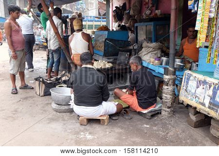KOLKATA, INDIA - FEBRUARY 10: Street trader sells fast food for hungry people on the busy street in Kolkata, India on February 10, 2016.