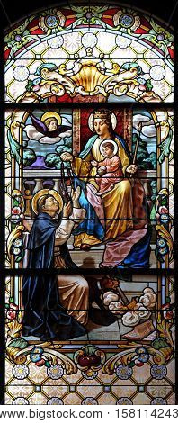 ZAGREB, CROATIA - JULY 02: Virgin Mary with baby Jesus and Saint Dominic, stained glass window in the Parish Church of the Visitation of the Virgin Mary in Zagreb, Croatia on July 02, 2015.