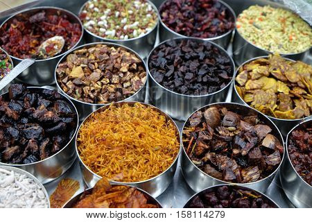 KOLKATA, INDIA - FEBRUARY 09: Different spices and herbs in metal bowls on a street market in Kolkata, West Bengal, India on February 09, 2016 in Kolkata, India.