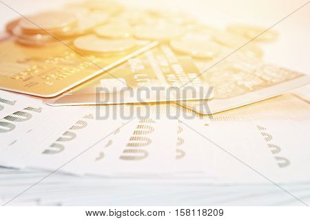 Business or finance background concept ; Coins, Thai money and credit cards on white background