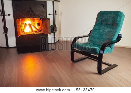 chair in front of fireplace