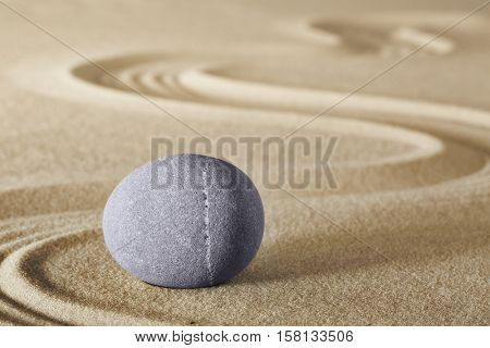 zen meditation stone with raked sand sheng fui buddhism spiritual japanese rock garden abstract harmony and balance concept for purity concentration spa relaxation