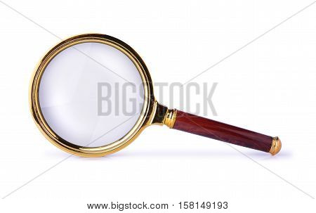 Vintage brass magnifying glass isolated on white background