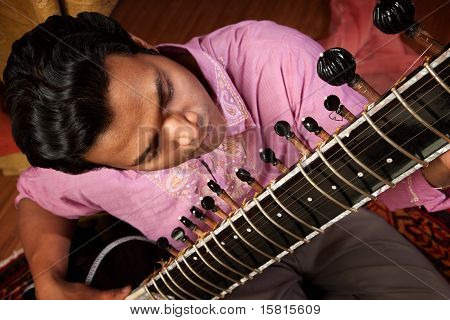 Indian Man Plays A Sitar