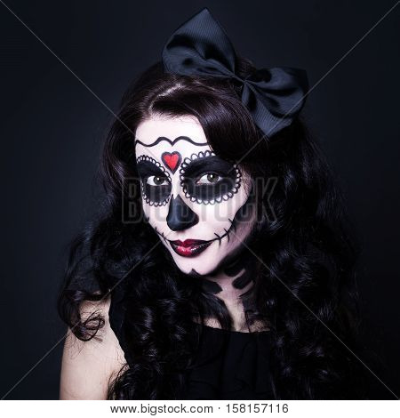 Young Smiling Woman With Halloween Skull Make Up Over Black