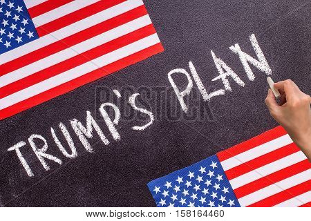Trump's Plan on the chalk board and US flag. Election concept