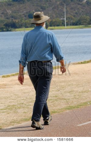 Senior Walking Along River