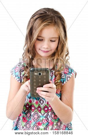 Cute little girl with mobile phone isolated on a white technology and internet concept