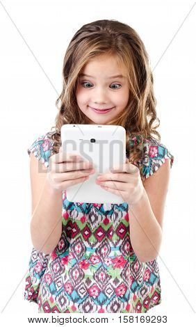Cute surprised little girl with tablet pc isolated on a white education and internet concept