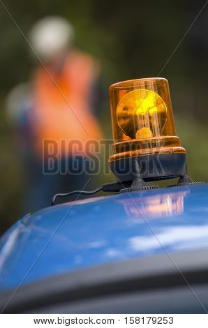 Orange Flashing And Revolving Light On Top Services Vehicle