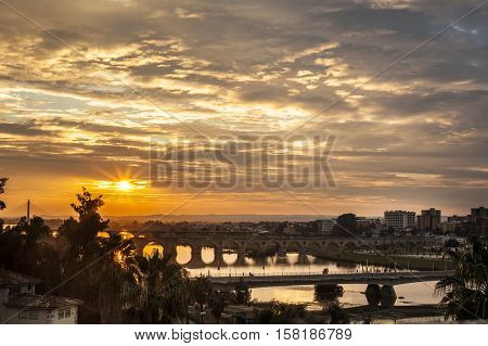 Four bridges of Badajoz City at sunset with cloudy sky Spain