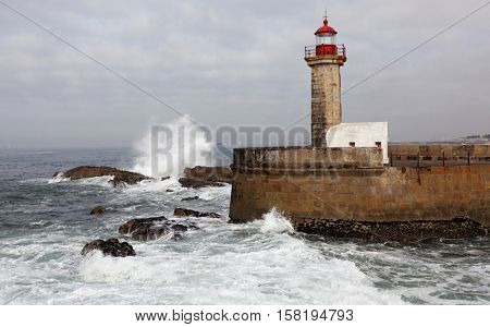 The Felgueiras Lighthouse at Douro river mouth in Foz do Douro, Porto, Portugal.