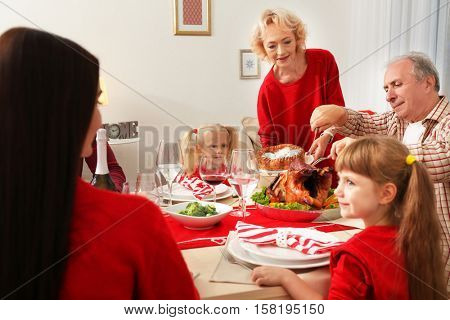 Family having Thanksgiving dinner in living room