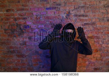 Burglar in wall at night