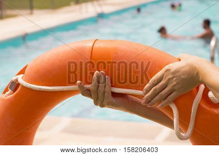 Woman catching lifeguard float in orange color