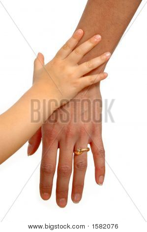 Child And Adult Hands