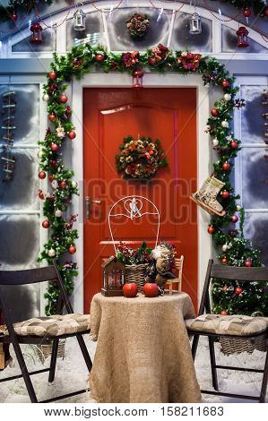 Porch With Red Door With Christmas Wreath