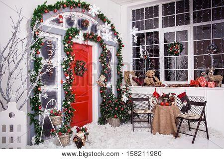 Winter Decoration. Red Door With Christmas Wreath